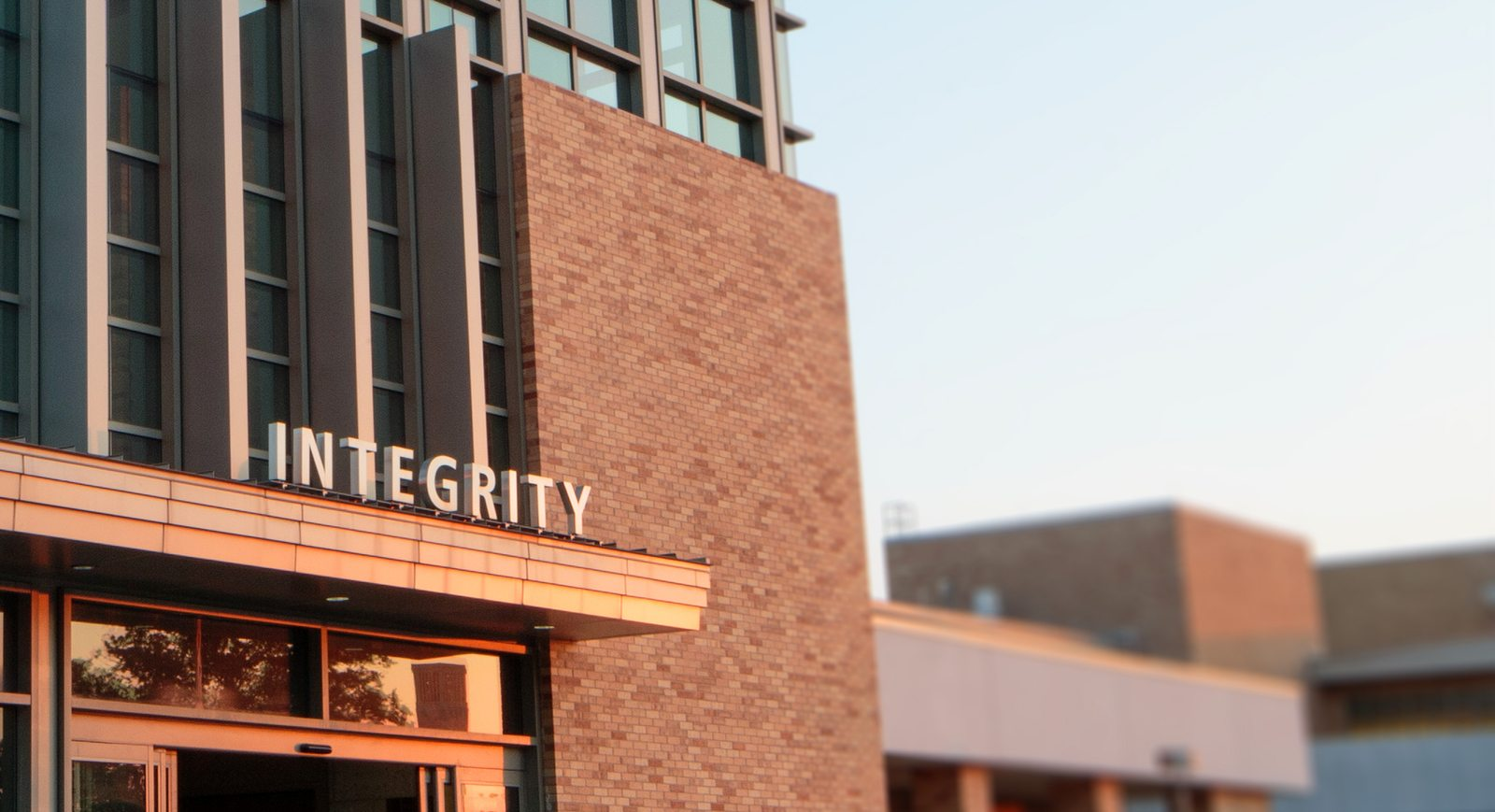 Photo of Texas A&M University Memorial Student Center entrance with the word Integrity about it