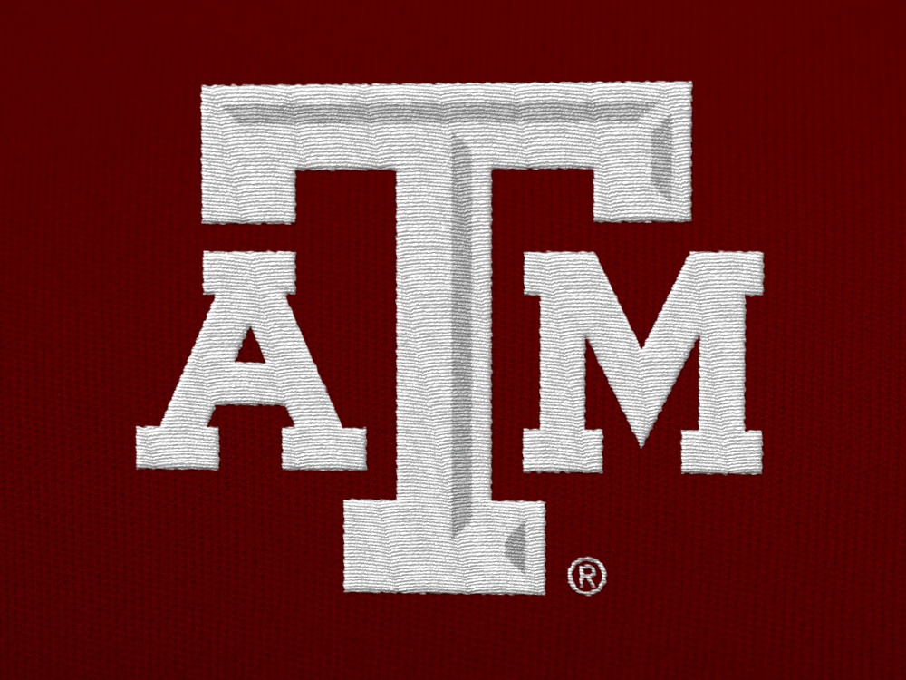 A white A&M logo embroidered on a maroon shirt